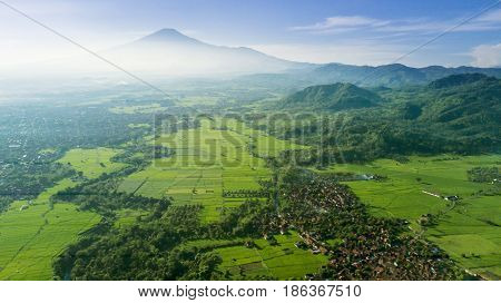 Beautiful top view of rice field and village in the mountain valley shot at Majalengka West Java Indonesia