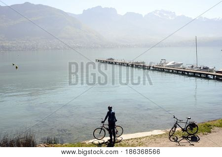 Cyclist in front of annecy lake and Tournette mountain France