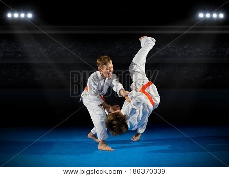 Children martial arts fighters at sports hall