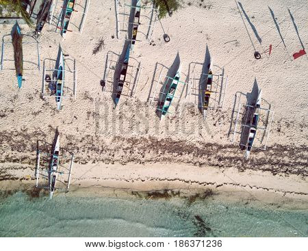 Bohol - April 2016: Aerial view of beach with bangkas fishing boats. Philippines