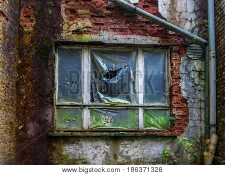 Window Under Plastic Film In The Brick Wall, Lost Place