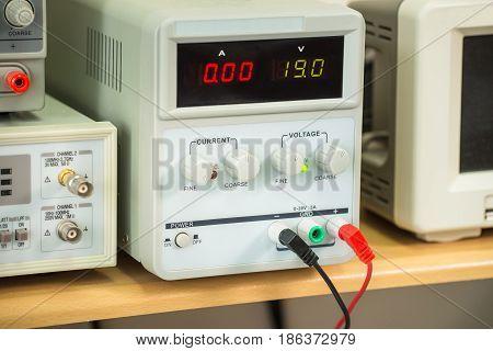 Laboratory power supply, professional equipment of repair service, closeup.