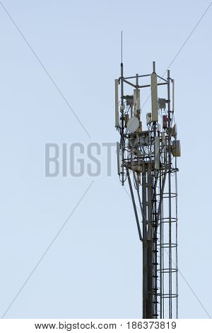 Cellular phone transmitter. Cell phone antenna with blue sky