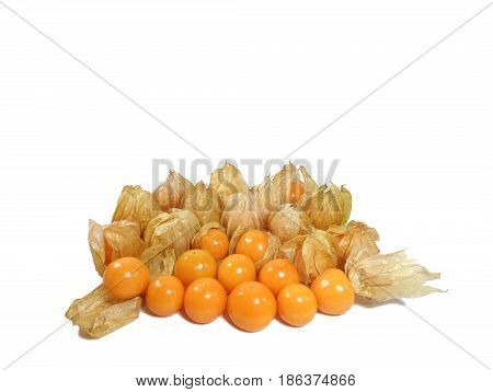 Heap of vibrant yellow ripe Cape Gooseberries with and without calyx, isolated on white background, with free space for text and design