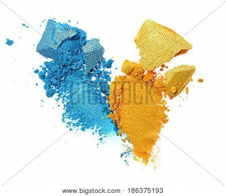 Smears Of Crushed Blue And Golden Shiny Eyeshadow As Sample Of Cosmetic Product