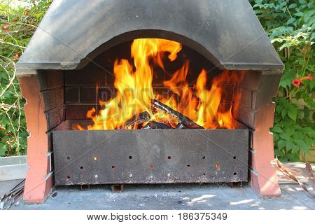 burning bright tongues of flame and brazier with shed