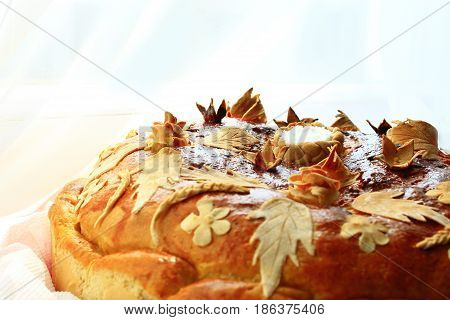 round loaf with floral patern of flowers and leaves