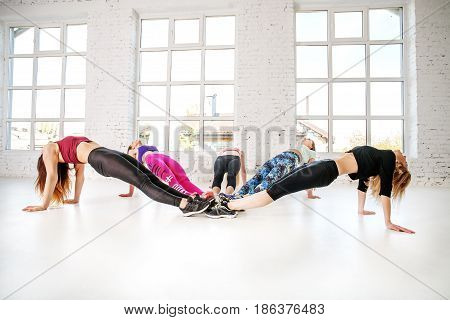 Group of girls yoga. The concept of sport dance and a healthy lifestyle.