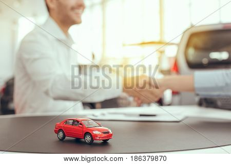 Young man and woman in a car rental service lease contract