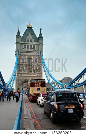 LONDON, UK - SEP 25: Tower Bridge with tourists and traffic on September 25, 2013 in London, UK. It is one of the iconic architectures in London and one of the most famous bridges in the world.