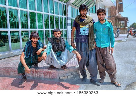 Bandar Abbas Hormozgan Province Iran - 16 april 2017: A group of young Afghan men in an Iranian city.