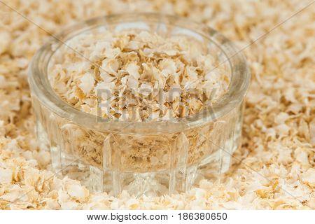 Quinoa flakes into a small glass container (Chenopodium quinoa)