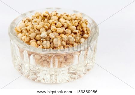 Puffed quinoa seeds (Chenopodium quinoa) isolated on white background