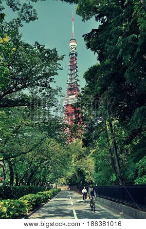 TOKYO, JAPAN - MAY 13: Street view with Tokyo Tower on May 13, 2013 in Tokyo. Tokyo is the capital of Japan and the most populous metropolitan area in the world