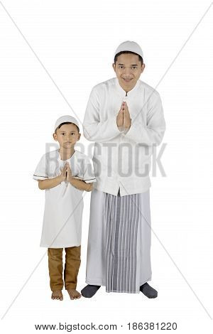Young father and son smiling and standing with welcoming gesture isolated on white background