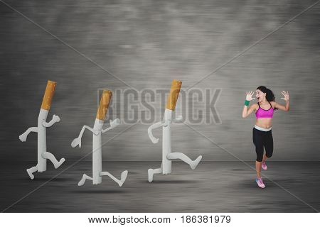 Portrait of an Indian woman escaping by three cigarettes while getting a bad hallucination