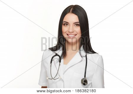 Female doctor with clipboard, isolated on white background. Friendly female doctor - isolated over a white background. Medicine and health care concept.