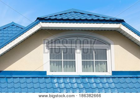 Modern roof blue metal roofing and skylight