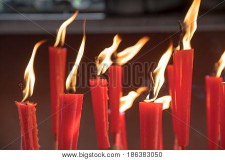 Red Candles at taoist shrine burning slowly