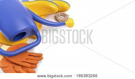 Watering can, rubber boots and working gloves on a white background.