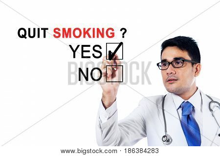 Image of young male doctor using a pen while agreeing about quit smoking on the whiteboard