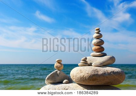 Double Rock Zen on the background of summer sea. Concept of harmony and balance.
