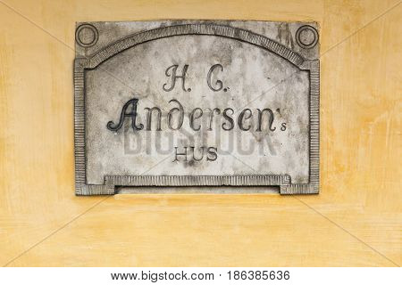 Odense, Denmark - April 2, 2017: Sign of the house and birth place of the storyteller Hans Christian Andersen in Odense, Denmark