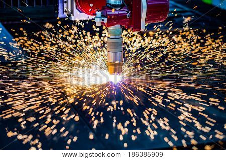 CNC Laser plasma cutting of metal, modern industrial technology. . Small depth of field. Warning - authentic shooting in challenging conditions. A little bit grain and maybe blurred.