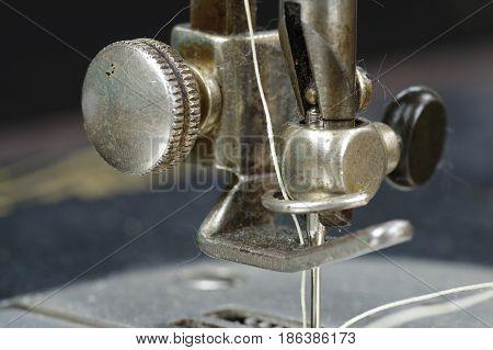 Macro photo of sewing machine parts. Machine foot.