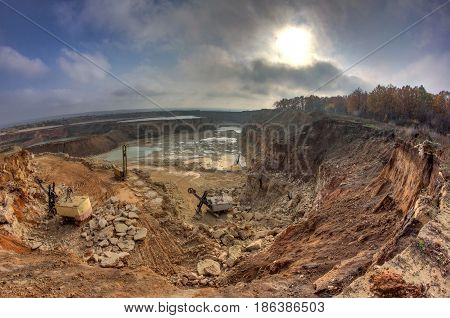 Work of excavators on limestone mining in a quarry