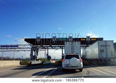 HAZEL CREST, ILLINOIS / UNITED STATES - NOVEMBER 20, 2016: Vehicles stop to pay tolls at the I-80 East Plaza 45.
