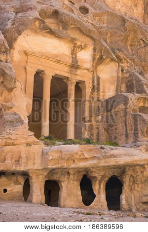 The ancient carved sandstone columns of Siq al Barid, Little Petra, Jordan. Buildings are formed from caves complete with cisterns for water collection. Little Petra was home to the Nabatean people.