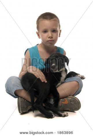 Boy Holding A Puppy