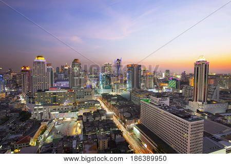 BANGKOK THAILAND - APRIL21 : beautiful sunset sky and building lighting at ratchaprarop road  in heart of bangkok business center  on april 21 , 2015 in bangkok thailand