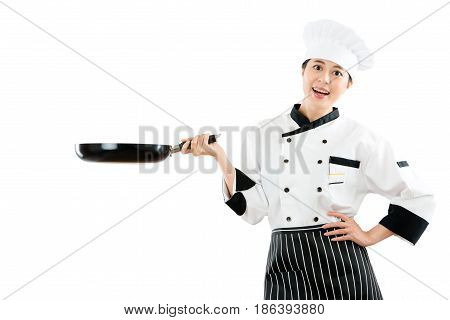 Chef Happily To Face The Camera Holding A Pan