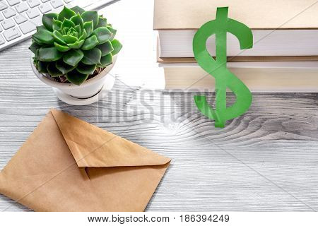 student's desk with dollar sign for fee-paying education set gray wooden background