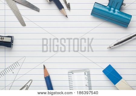 Stationery surrounding a writing paper creating copy space