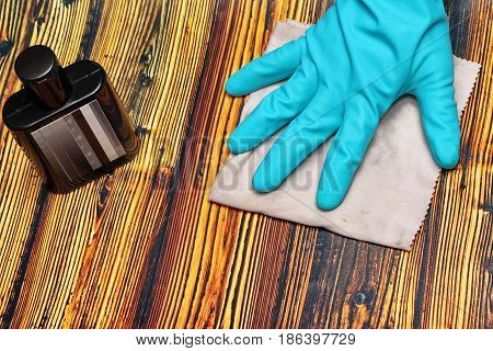 Wear rubber gloves and rubbed clean wood products by chemical polishing with a microfiber cloth.