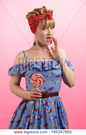 Cheeky pin up style image of woman with lollipop