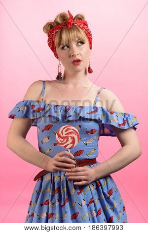 Pin up vintage style image of woman with lollipop