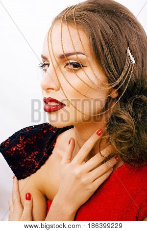 young pretty woman with fashion style makeup, chain like gussar role isolated on white background, red nails manicure, vintage hairstyle