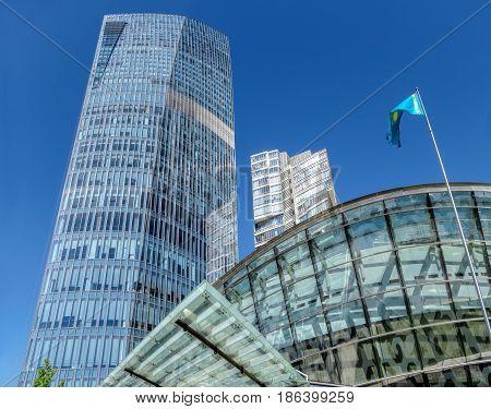 ALMATY KAZAKHSTAN - MAY 12 2017: The Ritz-Carlton Hotel on Al-Farabi street in Almaty Kazakhstan. It is a complex of buildings of Business Centre of Esentai Tower.