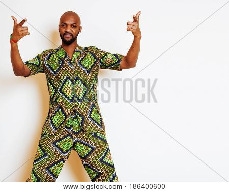 portrait of young handsome african man wearing bright green national costume smiling gesturing, entertainment stuff close up