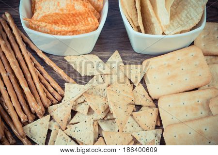 Vintage Photo, Heap Of Salted Crisps, Breadsticks And Cookies, Unhealthy Food Concept