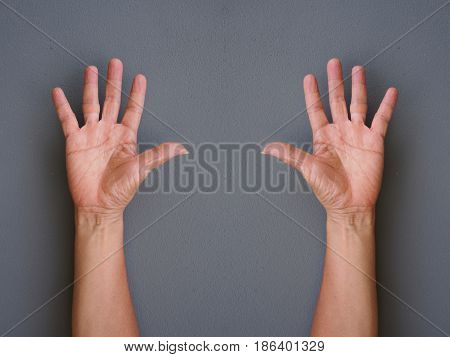 hands making raise hands up on gray background