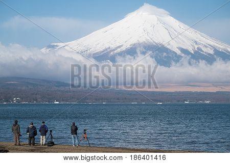 Group of Japanese photographer capturing Mt.Fuji and Yamanaka lake in morning.
