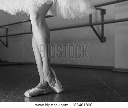 Ballerina in pointes and pack poses. Classical ballet. Prima ballerina. Shooting close-up. Black and white photography