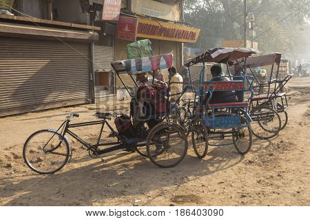 DELHI INDIA-MAR 21 : morning life of rickshaw driver at chandni chowk in old delhi of delhi on march 21 2015 india. rickshaw is three wheeler taxi for local area of Delhi