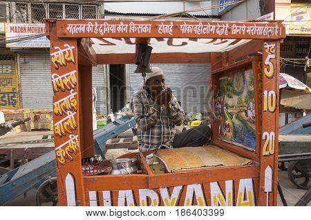 DELHI INDIA - JUN 7 : indian style ice cream bar cart stall in chawri bazar in old delhi of delhi on june 7 2015 india.