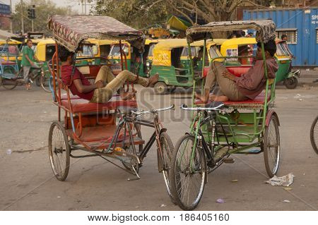 DELHI INDIA - MAY 5 : local rickshaw in front of old delhi railway station of delhi on may 5 2015 india. rickshaw is three wheeler bike taxi in any local area of delhi.